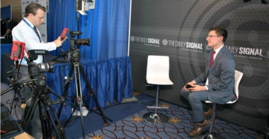 Michael Goodin, left, video production manager, lines up a shot Feb. 23 with Rob Bluey, editor-in-chief, on The Daily Signal's set at the Conservative Political Action Conference, or CPAC. (Photo: Jeff Malet/The Heritage Foundation)