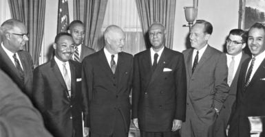 President Dwight Eisenhower talked about integrating public schools and other issues in a meeting June 23, 1958, with civil rights leaders Lester Granger of the Urban League, far left;  Martin Luther King Jr. of the Southern Christian Leadership Conference, second from left; Philip Randolph of the AFL-CIO, center; and, at far right, Roy Wilkins of the NAACP. (Photo: Everett Collection/Newscom)