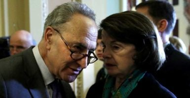 Senate Minority Leader Charles Schumer, D-N.Y., and Sen. Dianne Feinstein, D-Calif., talking after a Senate Democratic caucus meeting. (Photo: Yuri Gripas/Reuters/Newscom)