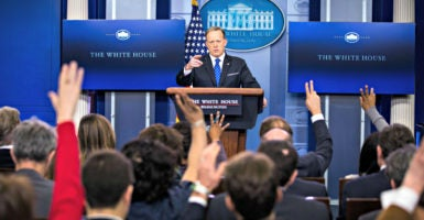 White House press secretary Sean Spicer fields questions March 22 in the briefing room of the White House. (Photo: Jim Lo/EPA/Newscom)