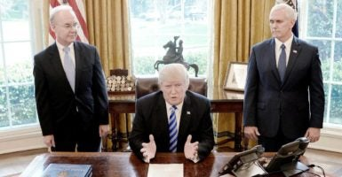 President Donald Trump talks to reporters in the Oval Office Friday after House Republicans pulled the bill to repeal and replace the Obamacare health law. He is flanked by Vice President Mike Pence, right, and Health and Human Services Secretary Tom Price, left. (Photo: Olivier Douliery/CNP/AdMedia/Newscom)