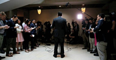 Reporters surround Rep. Devin Nunes, chairman of the House Permanent Select Committee on Intelligence, during a March 24 briefing in the Capitol on alleged government surveillance of the Trump transition team after the election. (Photo: Jonathan Ernst/Reuters/Newscom)
