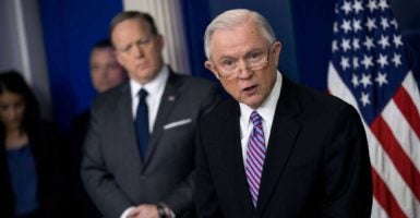 "Attorney General Jeff Sessions says he is ""urging states and local jurisdictions to comply with federal laws,"" or else they will lose federal funding.  (Photo: Shawn Thew/EPA/Newscom)"