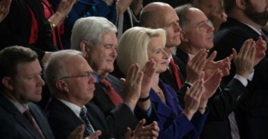 "Former House Speaker Newt Gingrich and wife Callista had a front-row balcony seat for President Donald Trump's Feb. 28 address to a joint session of Congress. At one point, Trump appealed to  Republicans and Democrats ""to save Americans from this imploding Obamacare disaster."" (Photo: Jeff Malet/Newscom)"