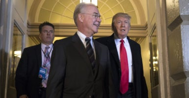 """Health and Human Services Secretary Tom Price, center, can change regulations to make it easier for web brokers to sell subsidized coverage to consumers. Web brokers are hoping under President Donald Trump, right,  HealthCare.gov becomes more of an """"information site."""" (Photo: Jim Lo Scalzo/UPI/Newscom)"""