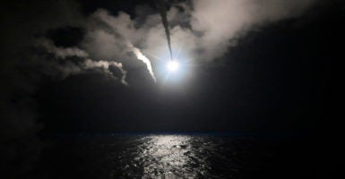 The USS Porter in the Mediterranean Sea launches Tomahawk cruise missiles at the Shayrat air base in Syria, April 7, 2017. (Photo: Ford Williams /Zuma Press/Newscom)