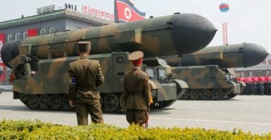 Missiles are driven along the streets in Pyongyang to celebrate the 105th birthday of North Korea's founding father, Kim Il Sung. The military parade was attended by North Korean dictator Kim Jong Un. (Photo: Sue-Lin Wong/Reuters /Newscom)