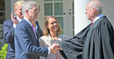 Nine days later, a big religious liberty case: Supreme Court Justices Neil Gorsuch, left, and Anthony Kennedy shake hands April 10 after Gorsuch's swearing-in at the White House. Looking on are President Donald Trump, who nominated Gorsuch, and the new justice's wife, Louise. (Photo: Ron Sachs/DPA Picture Alliance/Newscom)