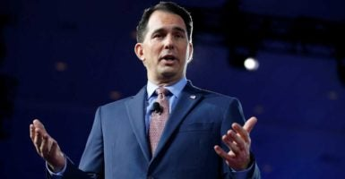 Wisconsin Gov. Scott Walker signed legislation that prevents local governments from requiring contractors to hire union labor for publicly funded construction projects.  (Photo: Joshua Roberts/Reuters/Newscom)