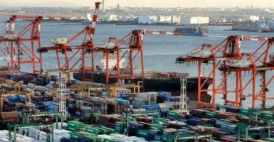 Cargo containers sit in a terminal in Yokohama, south of Tokyo, Japan.  (Photo: Kimimasa Mayama/EPA/Newscom)