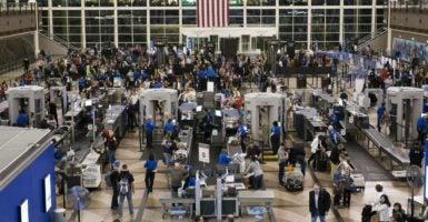 Travelers pass through security checkpoints inside Denver International Airport. (Photo: Eliott Foust/Zuma Press /Newscom)