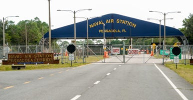 A general view of the atmosphere at the Pensacola Naval Air Station following a shooting on Dec. 6 in Pensacola, Florida. The shooting has left three innocent people dead and eight people wounded. width=