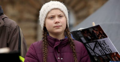 """Greta Thunberg"" -- the idea, not the girl -- is a concoction of activists who have increasingly taken to using children as a shield from critical analysis or debate. Pictured: Thunberg demonstrates with high school students against global warming at a demonstration on March 1, 2019 in Hamburg, Germany. (Photo: Adam Berry/Getty Images)"