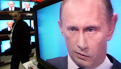 Vladimir Putin on TV (Photo by Alexey Sazonov/Newscom)