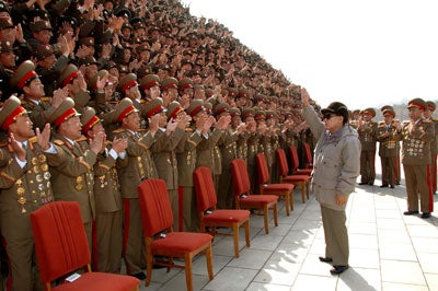 Kim Jong-il (R Front), top leader of the Democratic People's Republic of Korea (DPRK), meets with soldiers in Pyongyang