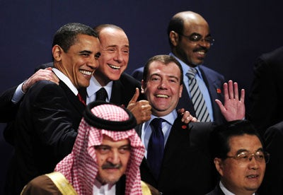 G20 leaders Saudi King Abdullah Bin Abdel Aziz (first row L), Chinese President Hu Jintao (first row R), (second row from L to R) US President Barack Obama, Italian Prime Minister Silvio Berlusconi, Russian President Dmitry Medvedev and New Partnership for Africa's Development (NEPAD) Meles Zenawi pose for a family photo during the G20 summit at the ExCel centre, in east London, on April 2, 2009.