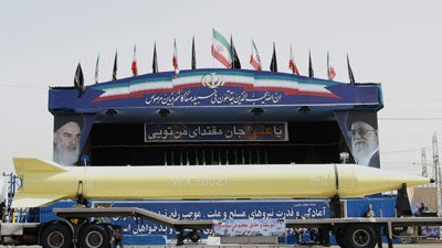 "A military truck carries a long-range Shahab-3 ballistic missile during a military parade in Tehran on September 21, 2008 to commemorate the 28th anniversary of Iran's 1980-1988 war with Iraq. Iranian President Mahmoud Ahmadinejad said today the country's military will ""break the hands"" of invaders if attacked, amid its continuing nuclear standoff with the West."