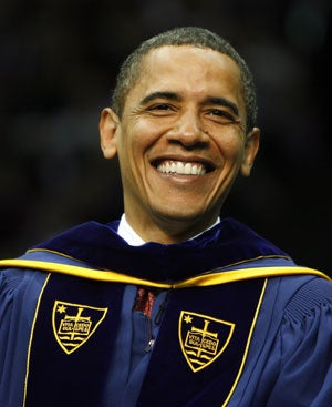 U.S. President Barack Obama reacts during the Notre Dame University 164th commencement ceremonies on the campus of Notre Dame University in South Bend, Indiana May 17, 2009. Obama received an honorary law degree from the university during the commencement.