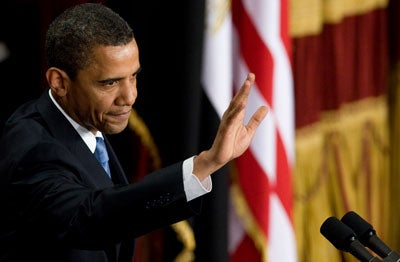 "US President Barack Obama waves at the end of his highly-anticipated address to the Muslim world on June 4, 2009 in the Grand Hall of Cairo University in Cairo. Obama vowed to forge a ""new beginning"" for Islam and America in a landmark speech to the world's Muslims, evoking a vision of peace after a smouldering cycle of ""suspicion and discord."""