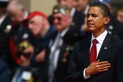 US President Barack Obama attends the 65th D-Day anniversary at the Normandy American Cemetery and Memorial at Colleville-sur-Mer, Normandy, France on June 6 2009.