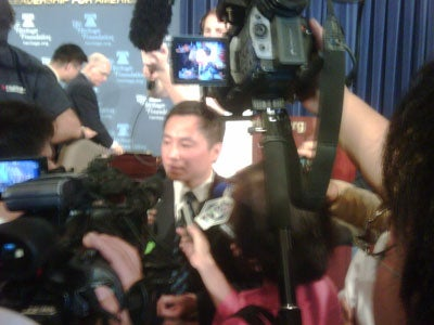 Dr Wang Dan is mobbed by reporters after speaking with Heritage's Lee Edwards