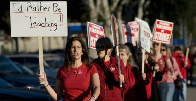 Teachers picket in front of Walnut Elementary School in La Habra, Calif. (Photo: Joshua Sudock/Zuma Press/Newscom)