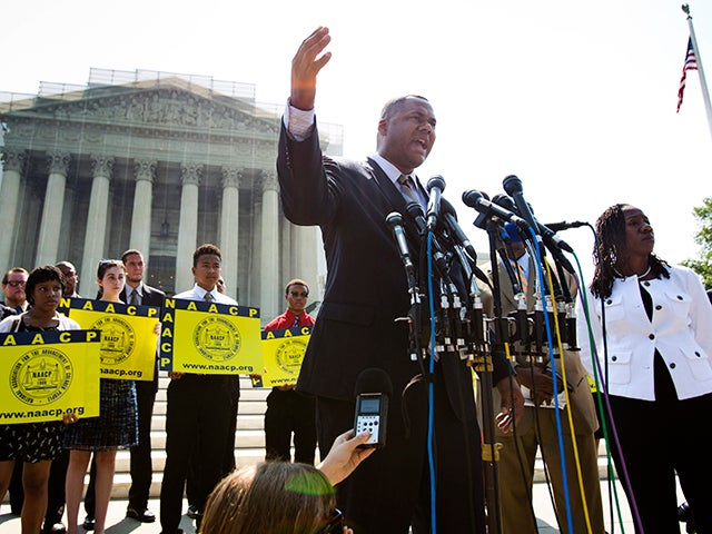 Ryan Haygood, the Director of the NAACP Legal Defense and Educational Fund, gathers with civil rights activists outside the Supreme Court to protest the high court's decision to strike down part of the Voting Rights Act of 1965 in Washington, DC in June 2013. / EPA/JIM LO SCALZO
