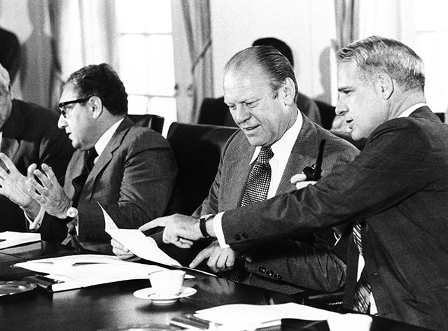 Gerald Ford at a Cabinet meeting during his first month as President. L-R: Henry Kissinger, Secy. of State; Pres. Ford; James Schlesinger, Defense Secy. Aug. 26, 1974. Photo: CSU Archives/Everett Collection/Newscom