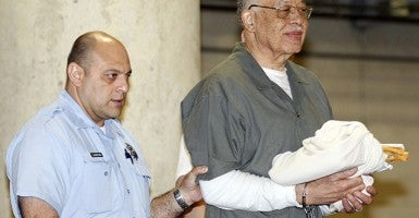 Dr. Kermit Gosnell, 72, right, gets escorted to a van leaving the Criminal Justice Center after getting convicted on three counts of first degree murder on Monday, May 13, 2013, in Philadelphia, Pennsylvania. (Photo: Yong Kim/Philadelphia Inquirer/MCT)