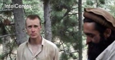In this filed still image provided by IntelCenter on December 7, 2010 shows the Taliban associated video production group Manba al-Jihad December 7, 2010 release of someone that appears to be US soldier Bowe Bergdahl (L), who has been held hostage by the Taliban since his disappearance from his unit on June 30, 2009. (Photo: Newscom)