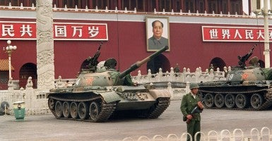 A picture taken on June 9, 1989 showing a soldier standing guard in front of People's Liberation Army tanks at Tiananmen Square after a military crackdown. (Photo: Newscom)