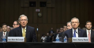 Senate Minority Leader Mitch McConnell (R-Ky.) and Senate Majority Leader Harry Reid (D-Nev.) testify during a Senate Judiciary Committee hearing on a constitutional amendment on campaign finance. (Photo: UPI/Newscom)