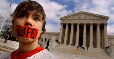 A pro-life activist in front of the U.S. Supreme Court. (Photo: Newscom)