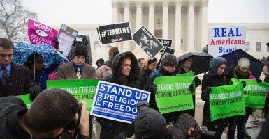 Protestors against the ObamaCare contraception mandate gather to pray outside the United States Supreme Court in March. (Photo: Jeff Malet/Newscom)