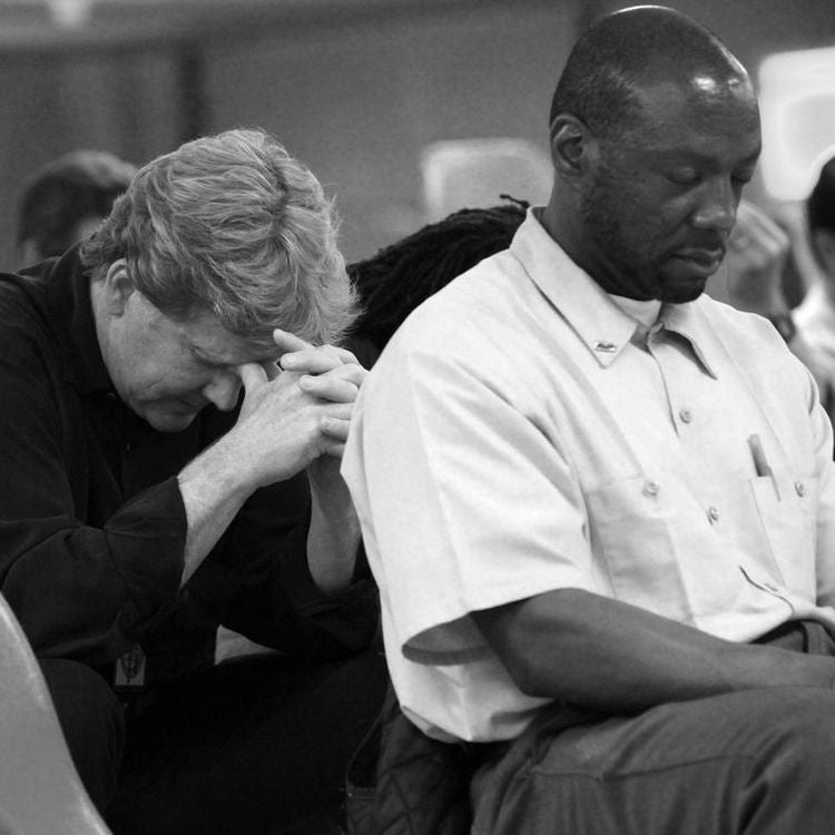'The least of the least': B. Wayne Hughes Jr. prays with inmates at California's Centinela State Prison (Photo: Serving California)