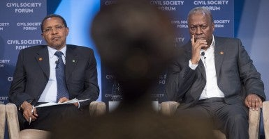 President of Tanzania Jakaya Kikwete, left, and President of Ghana John Dramani Mahama, right, listen to a question from a member of the audience during the Civil Society Forum at the US Africa Leaders Summit in Washington DC, USA, 04 August 2014 (Photo:Reynolds/Newscom).