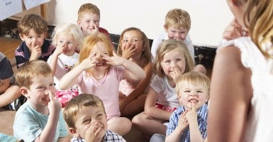Montessori Class Listening to Teacher (Photo: ThinkStockPhoto).