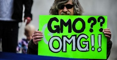 A man holds an anti-GMO sign during a protest against Monsanto. (Photo:Tracy/NurPhoto/Newscom)