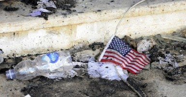 A small American flag is seen in the rubble at the United States consulate, one day after armed men stormed the compound and killed the U.S. Ambassador Christopher Stevens and three others in Benghazi, Libya on September 12, 2012.  UPI/Tariq AL-hun  [Photo via Newscom]