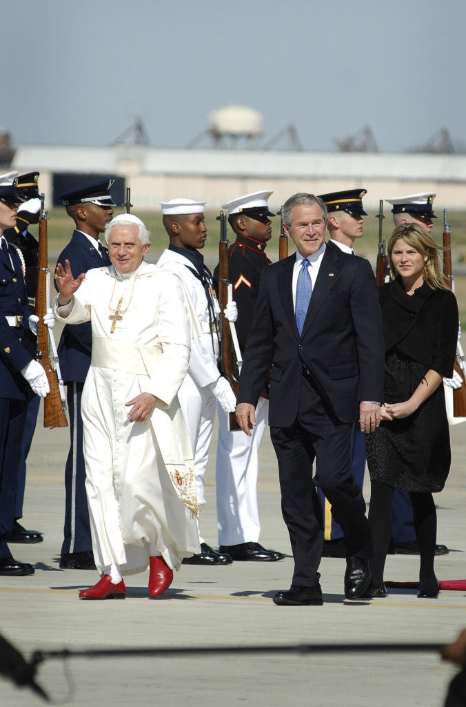 President George W. Bush escorts Pope Benedict XVI at Andrews Air Force Base, Md., April 15, 2008, at the start of his weeklong trip to the United States.