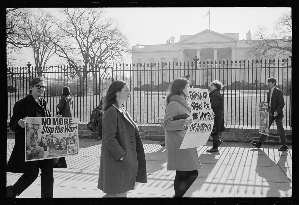 "Anti-war demonstrators carry signs, ""No more...Stop the war!"" as singer Eartha Kitt speaks for the women of America in front of the White House in 1968. (Photo: Library of Congress)"