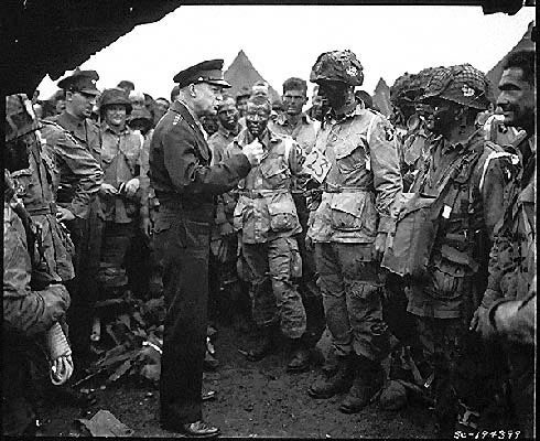 Supreme Allied Commander U.S. Army Gen. Dwight D. Eisenhower speaks with 101st Airborne Division paratroopers before they board airplanes and gliders to take part in a parachute assault into Normandy. (Photo: U.S. Army/Flickr)