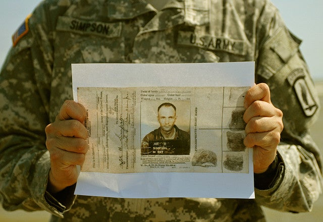 Pfc. Scott Simpson, a medic with Headquarters Company, 173rd Airborne Brigade Combat Team, holds a copy of his grandfather's military identification card from World War II on Normandy's Utah Beach, June 4. His grandfather landed on the beach with the 4th Infantry Division as part of the third wave of Operation Overlord, on June 6, 1944. (Photo: US Army/Sgt. Fay Conroy)