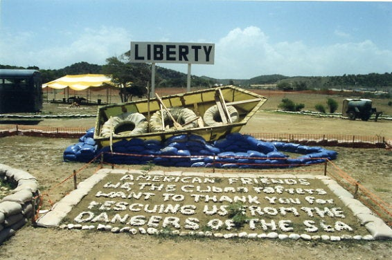 "A memorial erected at Guantanamo Bay thanking ""American friends"" for ""saving us from the dangers of the sea"" in 1995. (Photo: Duke University Library, Elizabeth Campisi/CC By 2.0)"