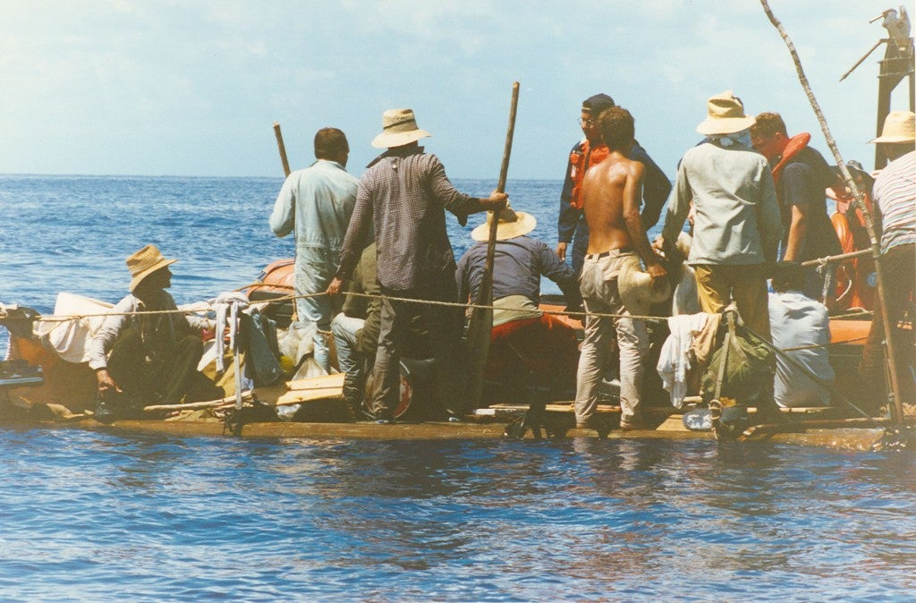 A Cuban raft lists to one side as Coast Guard officials come aboard to rescue refugees. (Photo: U.S. Coast Guard Historian Office/CC By 2.0)
