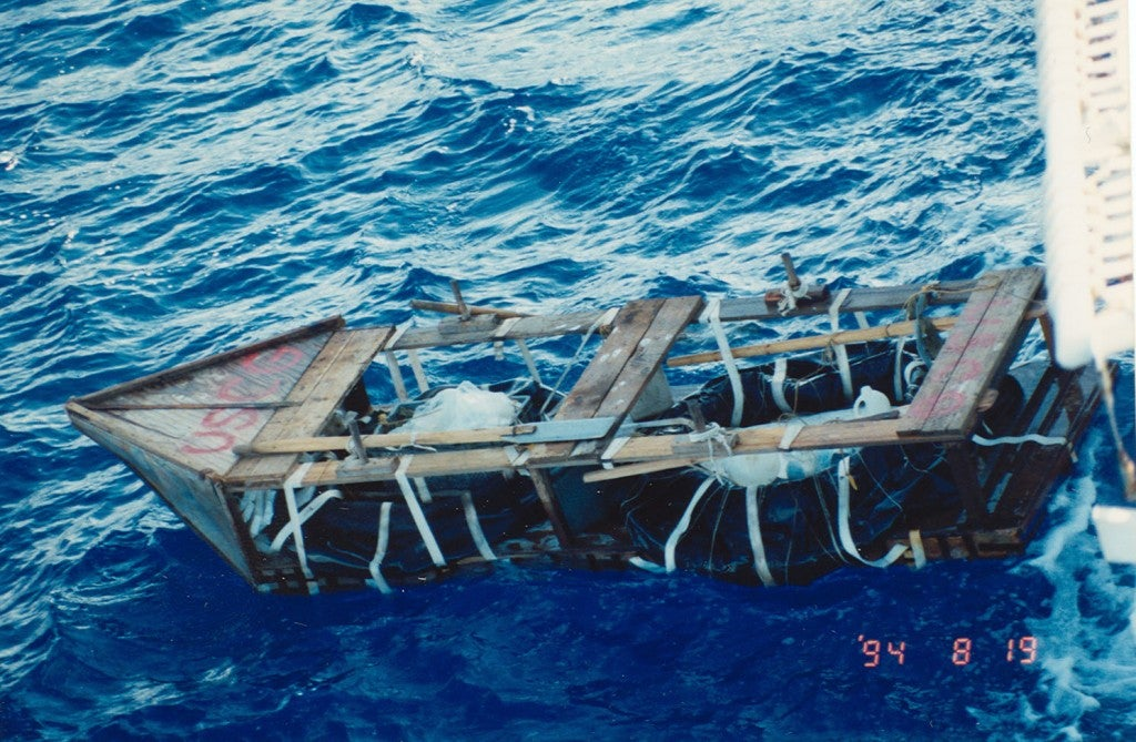 "The Coast Guard saved so many refugees that their discarded craft had to be marked ""USCG"" to notify helicopters that the refugees had been safely rescued, August 1994. (Photo: U.S. Coast Guard Historian Office//CC By 2.0)"