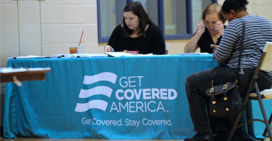 A woman applies for medical coverage at a health insurance marketplace enrollment center in Orlando, Fla. (Photo: Paul Hennessy/Polaris/Newscom)