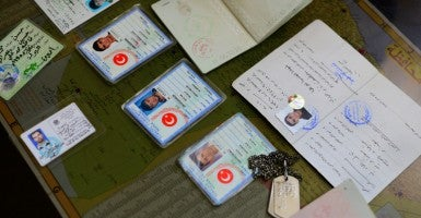 The ID cards of Turkish nationals and Turkish military dog tags and military ID tags of foreign fighters who have joined the Islamic State of Iraq and Syria (ISIS). (Photo: Alfred Yaghobzadeh/Polaris/Newscom)
