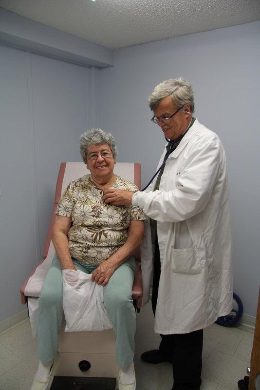 Dr. John Eck sees a patient at the Zarephath Health Center. (Photo: Dr. Alieta Eck)