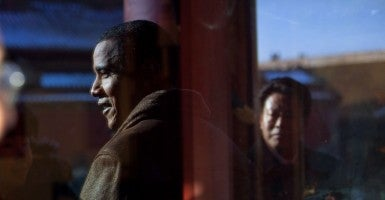 President Barack Obama is reflected in a window while touring the Forbidden City in Beijing, China. (Official White House Photo by Pete Souza)